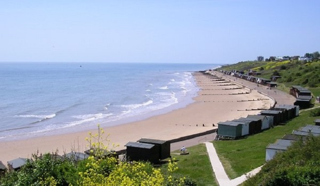 Photo of Frinton beach with beach huts.